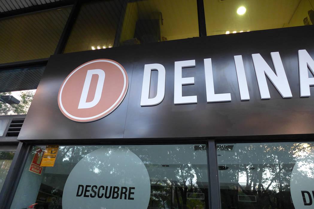 Rótulo para Delina's: Espacios comerciales de estilo  de Trama
