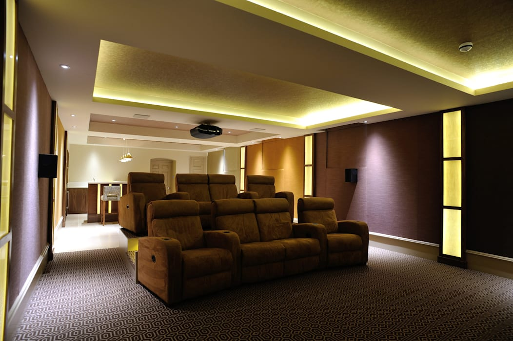 Fabric walling in cinema room:  Media room by Mille Couleurs London,