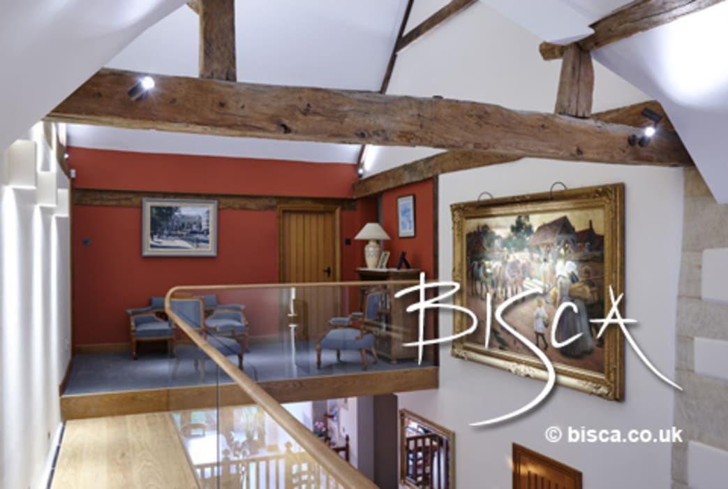 Glass Balustrade in farmhouse conversion:  Living room by Bisca Staircases,