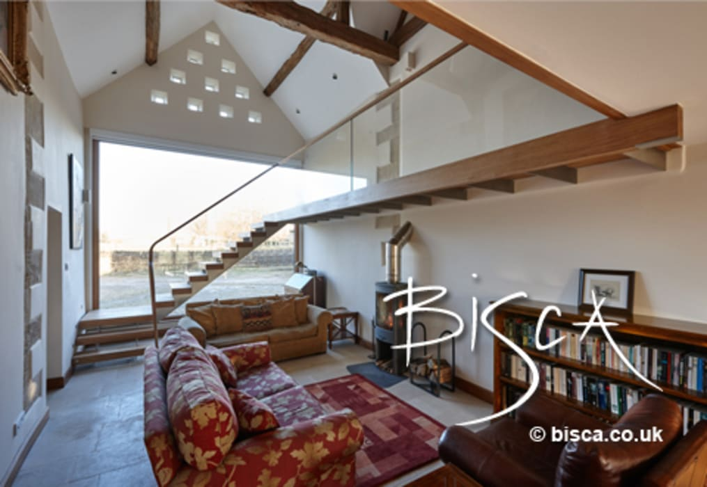 Landing and Stairs in farmhouse conversion:  Living room by Bisca Staircases,