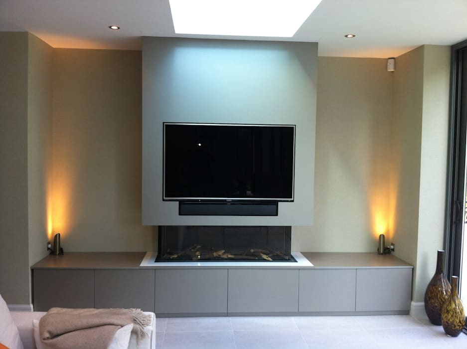 Flush fitting TV and cabinets:  Living room by Designer Vision and Sound,