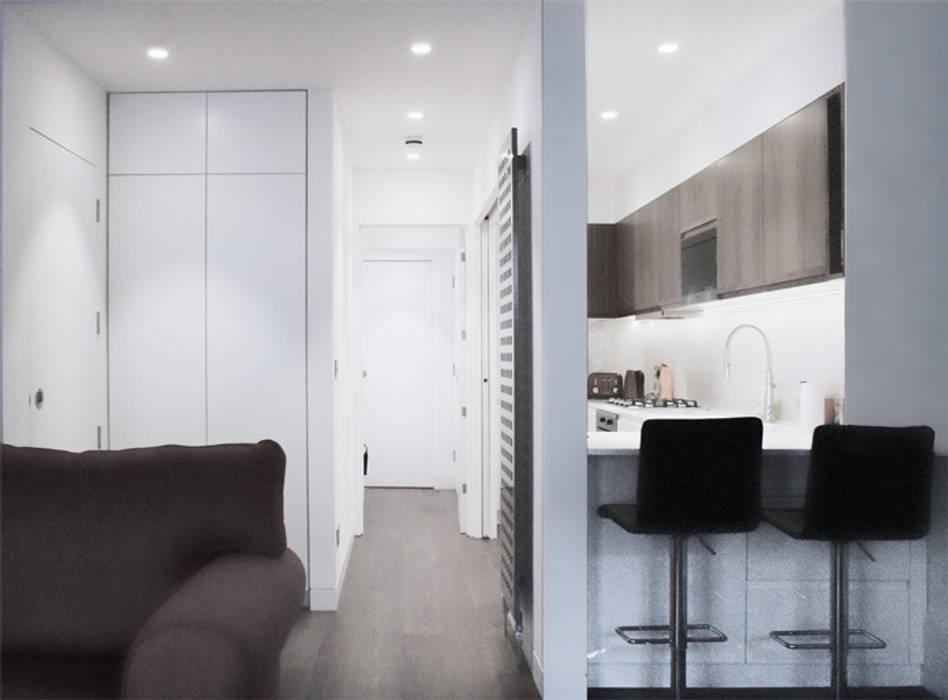 Corridor and Kitchen Modern kitchen by CBOArchitects Modern