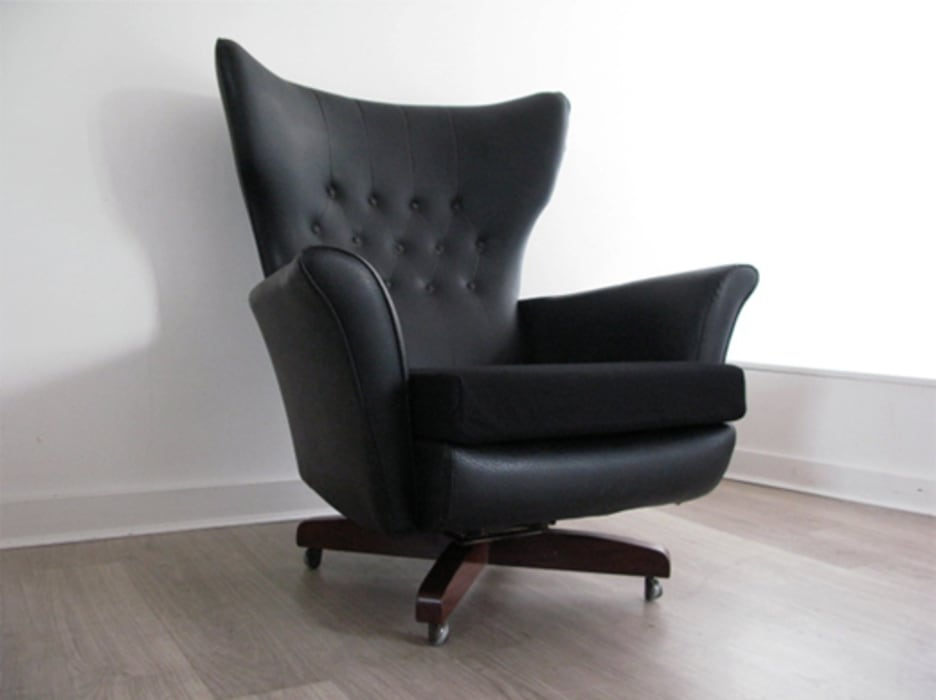 Black faux leather swivel chair with contrasting black fabric seat on a solid teak base Funky Junky Living roomSofas & armchairs