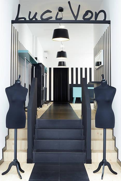 Luci Von. Local comercial para tienda de ropa Estudios y despachos de estilo ecléctico de Estudio de Arquitectura Sra.Farnsworth Ecléctico