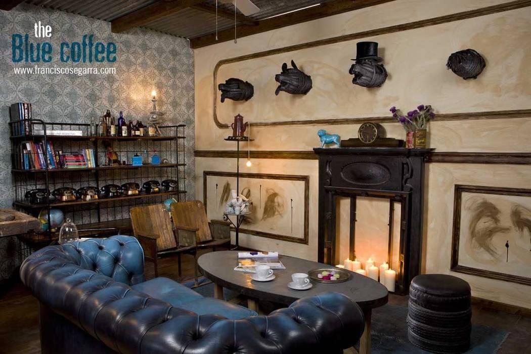 Chimeneas victorianas, sofás Chester originales... Francisco Segarra. Gastronomía de estilo ecléctico de Francisco Segarra Ecléctico