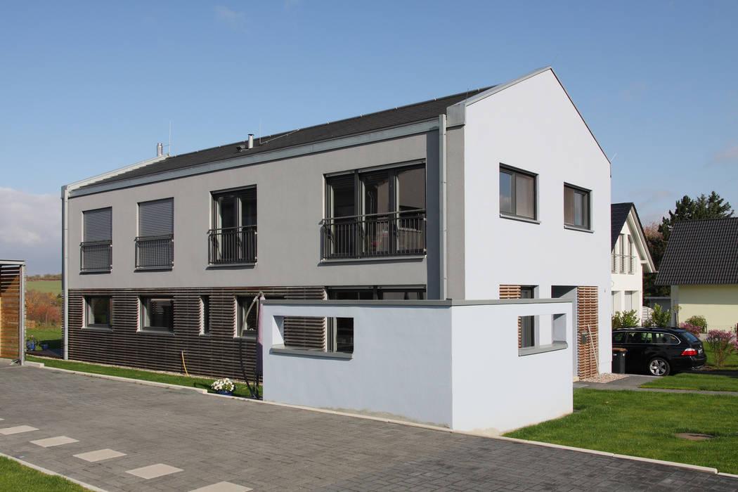 Casas modernas de skt umbaukultur Architekten BDA Moderno