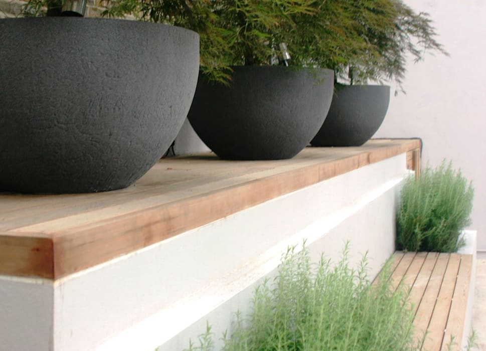 Large planters and seating by Rae Wilkinson Rae Wilkinson Design Ltd Modern garden
