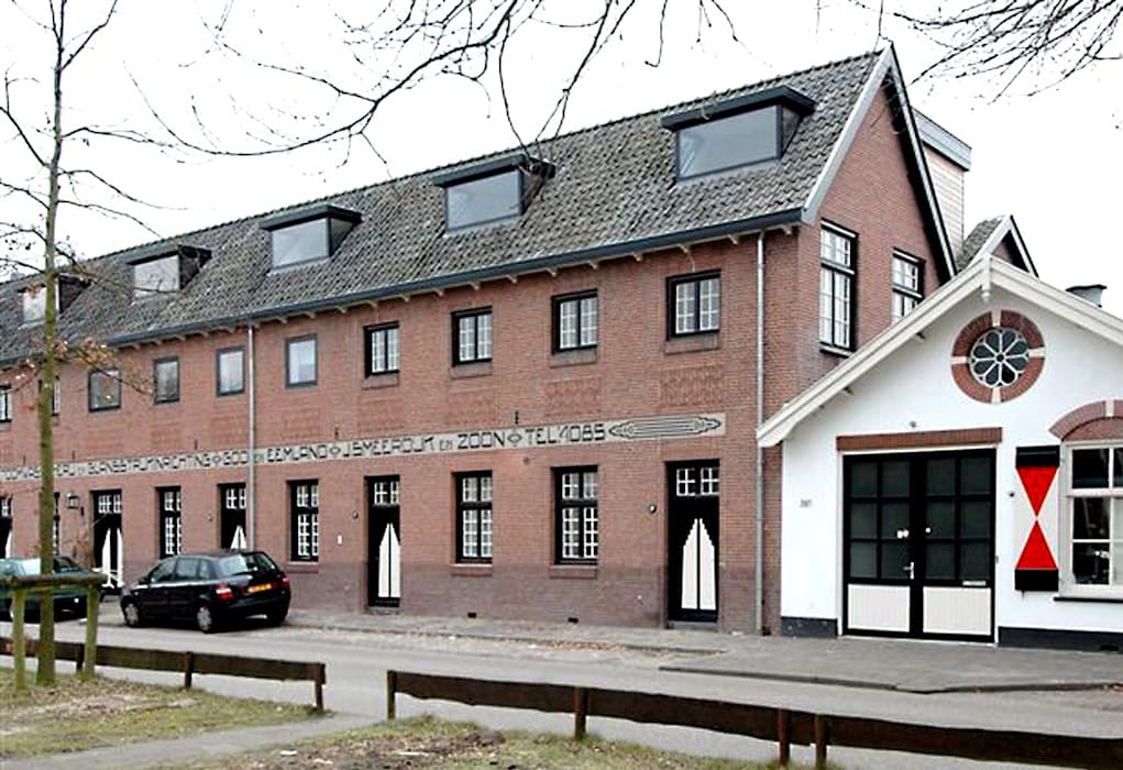 Loft in oude textielfabriek:  Huizen door Archivice Architektenburo , Industrieel