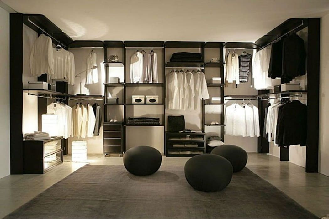 Colonial style dressing room by MUEBLES RABANAL SL Colonial