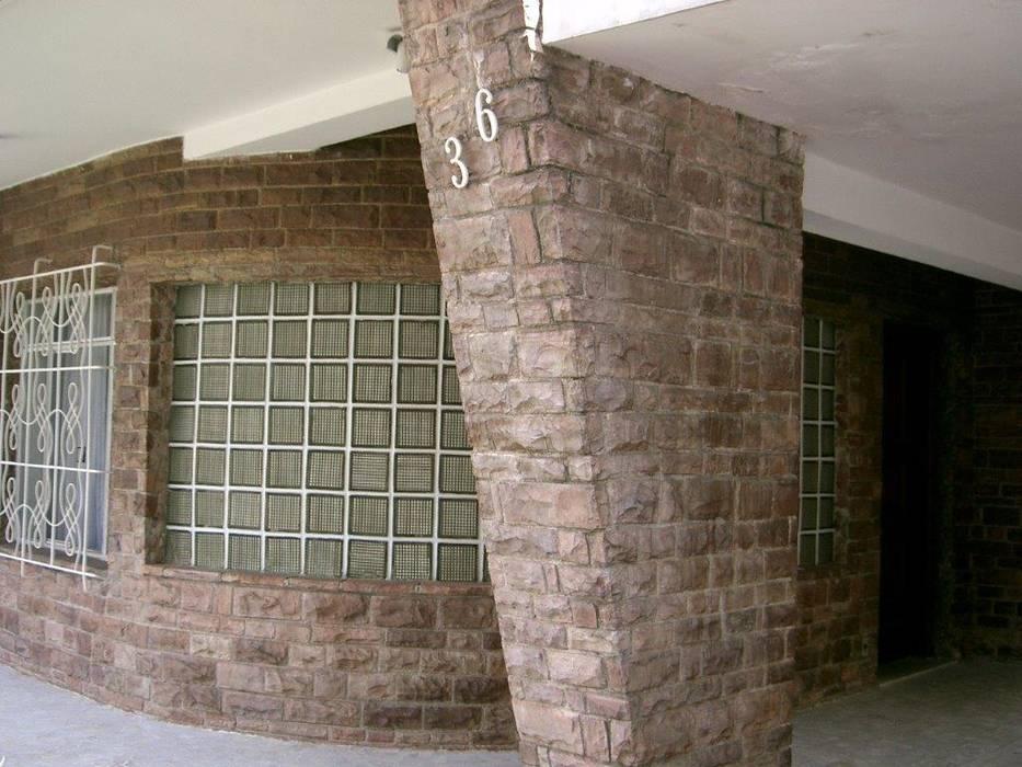 de estilo colonial de Ornella Lenci Arquitetura, Colonial