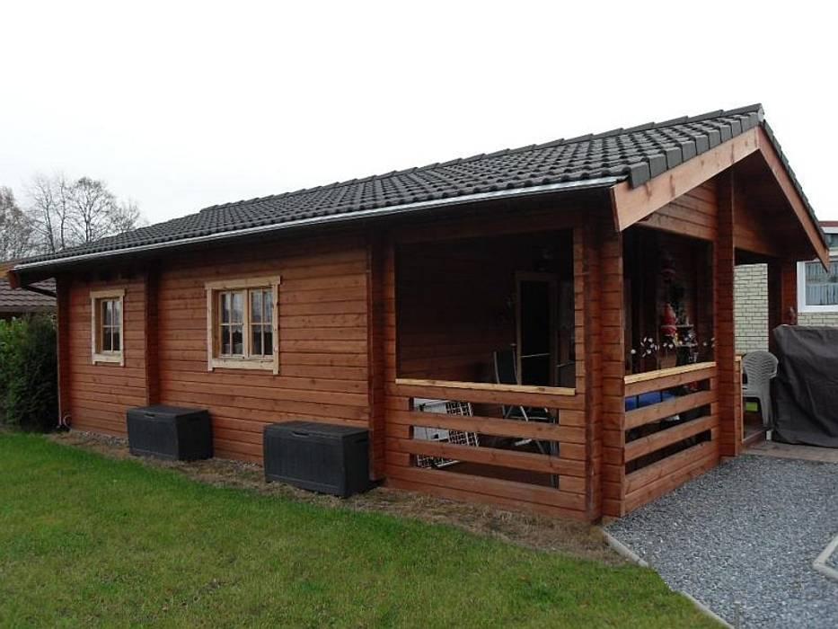 Дома в скандинавском стиле от Betana Blockhaus GmbH Скандинавский