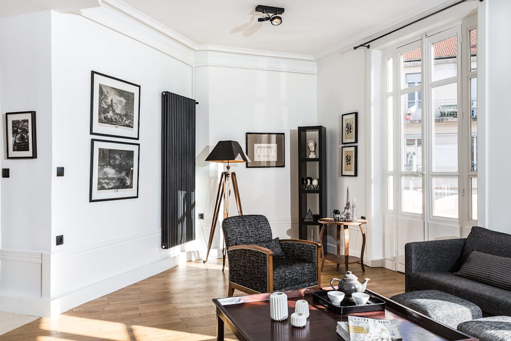 Rénovation d'un appartement à Lyon 6e: Salon de style  par Stellati Rénovation