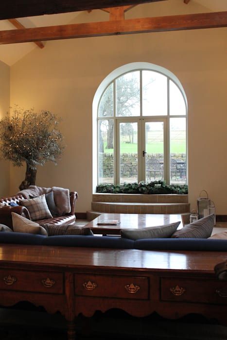 Beautiful Feature Window into the Fields:  Living room by Vanessa Rhodes Interiors