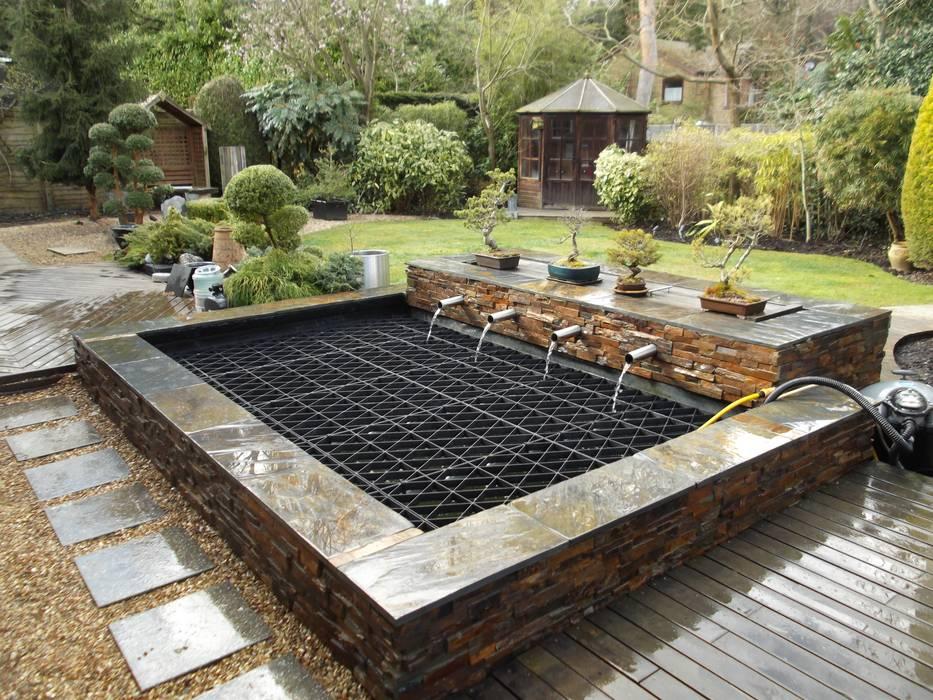 Natural stone pond Modern garden by Aquajoy water gardens ltd Modern