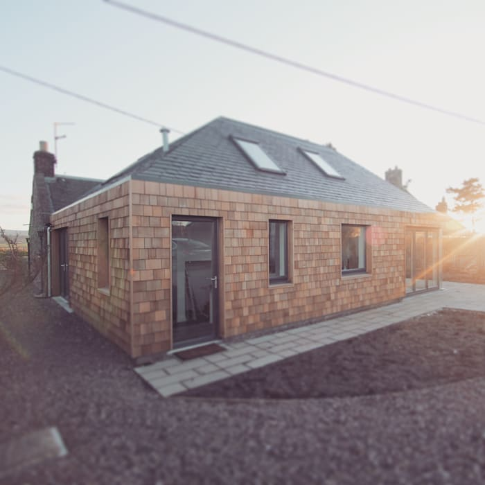Rear elevation showing timber shingle cladding:  Houses by A449 LTD,