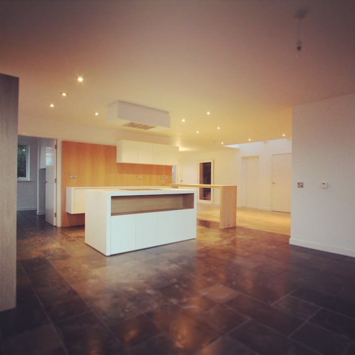 View of kitchen from dining area Modern kitchen by A449 LTD Modern
