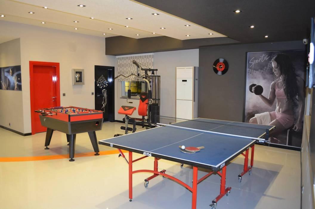 Emre Urasoğlu İç Mimarlık Tasarım Ltd.Şti. – Bomak Hobby Center - Adana:  tarz Fitness Odası, Modern