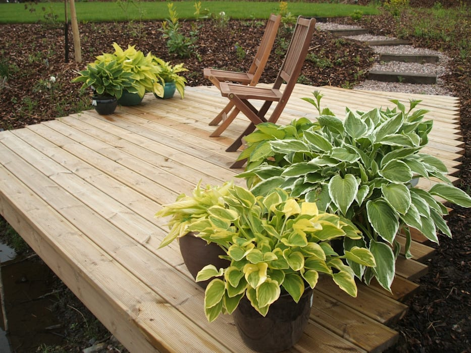 Decking Сад в классическом стиле от Unique Landscapes Классический