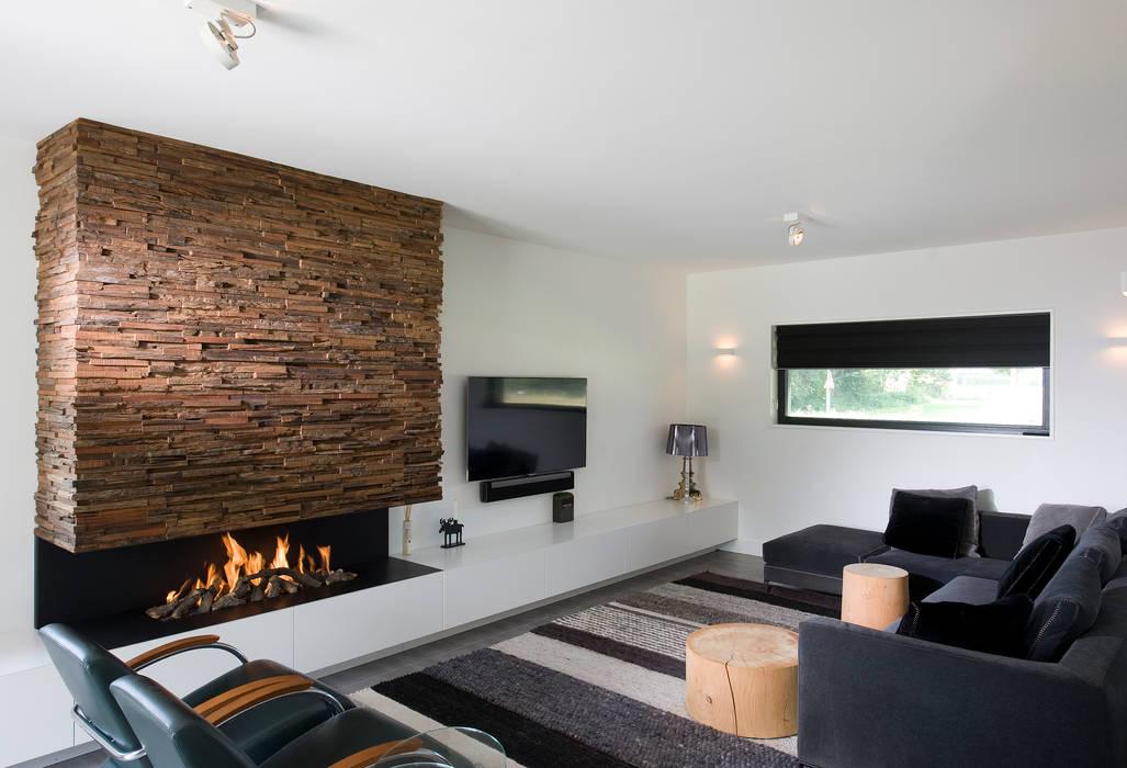 Living room by Wonderwall Studios, Modern