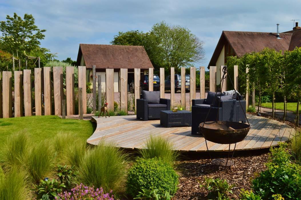 Jardin de style  par Unique Landscapes, Rural