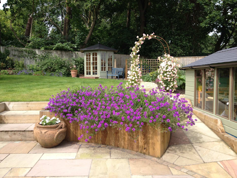 Rose arch with new paved seating area Country style gardens by Roeder Landscape Design Ltd Country