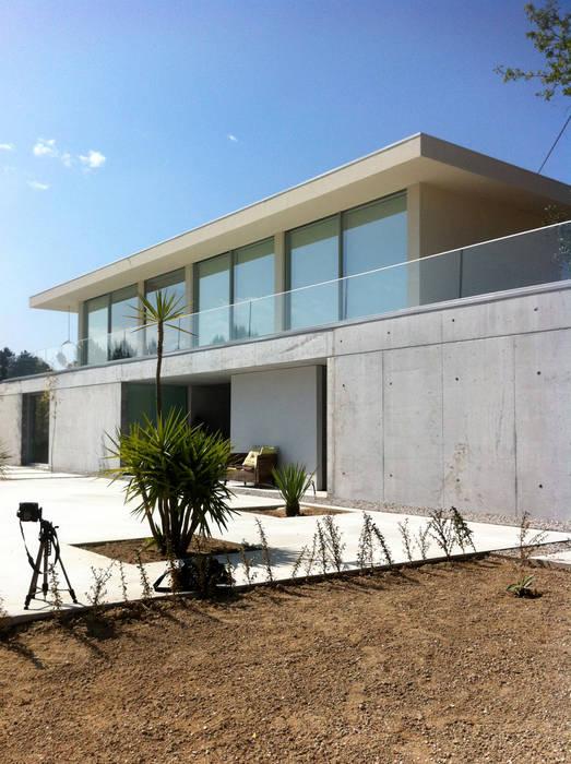 Casa Cláudia Casas minimalistas por homify Minimalista
