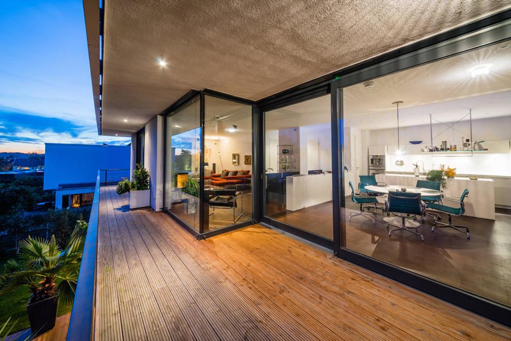 opEnd house - Single Family House in Lorsch, Germany Varandas, marquises e terraços modernos por Helwig Haus und Raum Planungs GmbH Moderno
