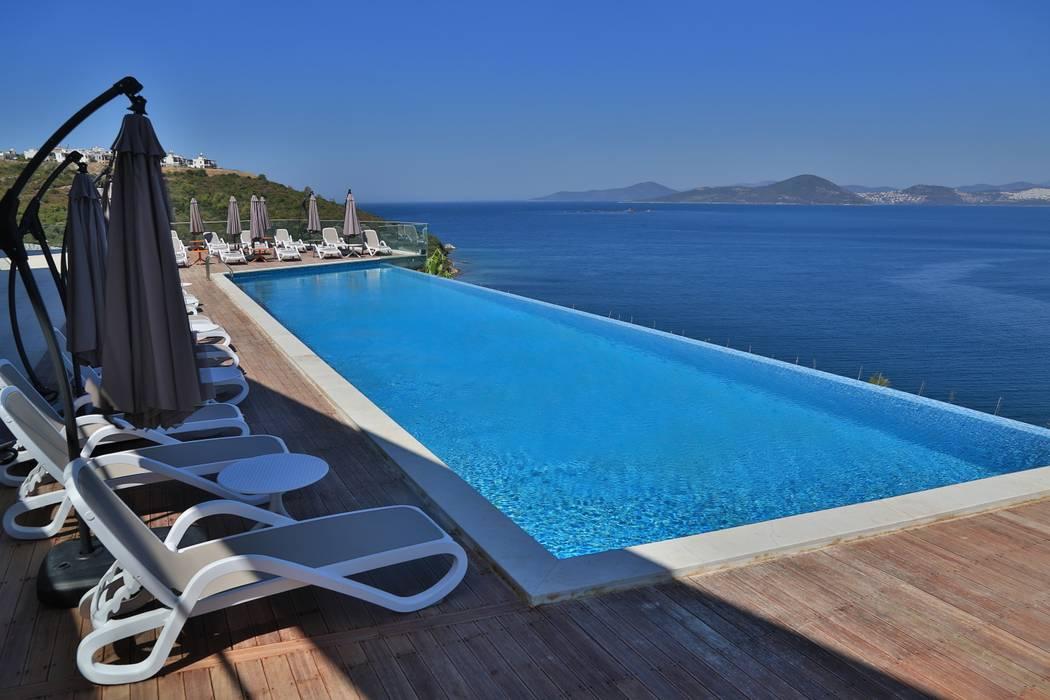 Hồ bơi phong cách hiện đại bởi Seba Holding Hiện đại