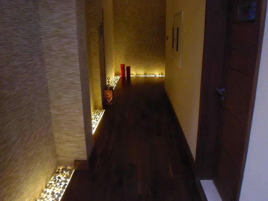 Spa Corridor:  Commercial Spaces by Elektra Lighting Design,