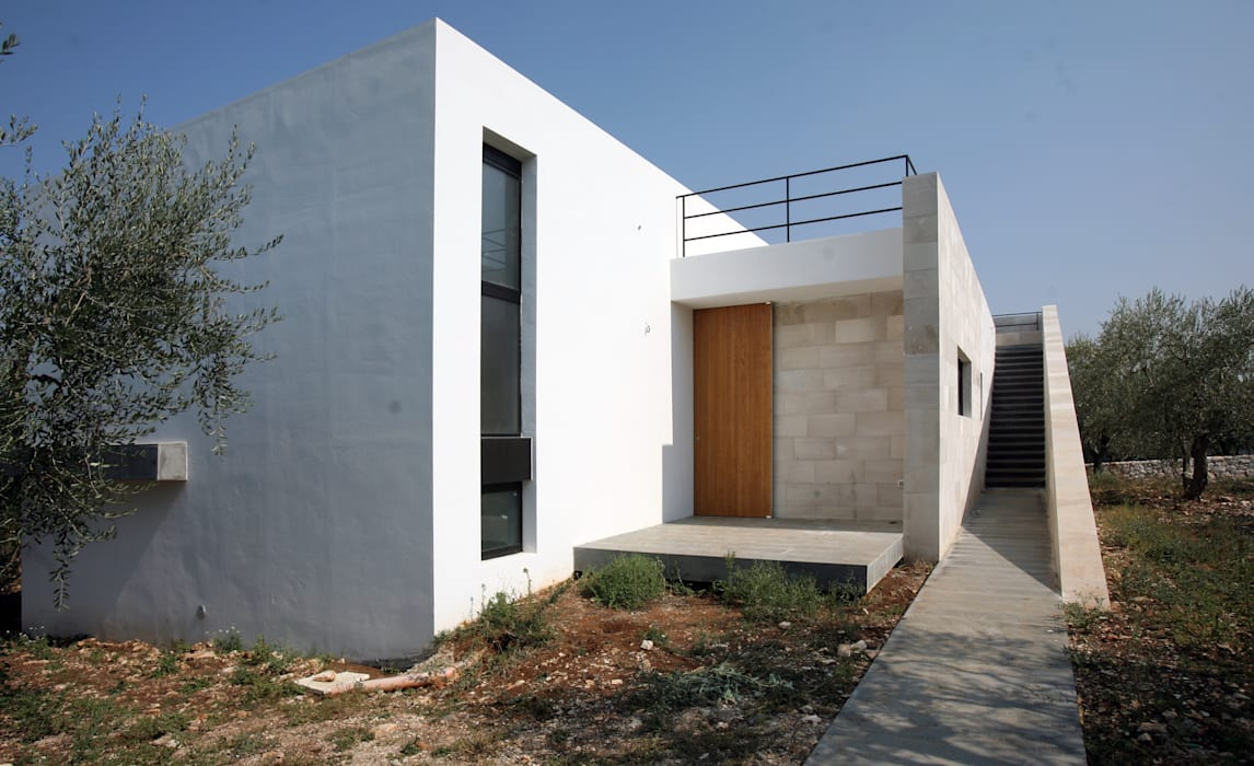 CASA N - Villa in Puglia: Case in stile in stile Minimalista di Giandomenico Florio Architetto