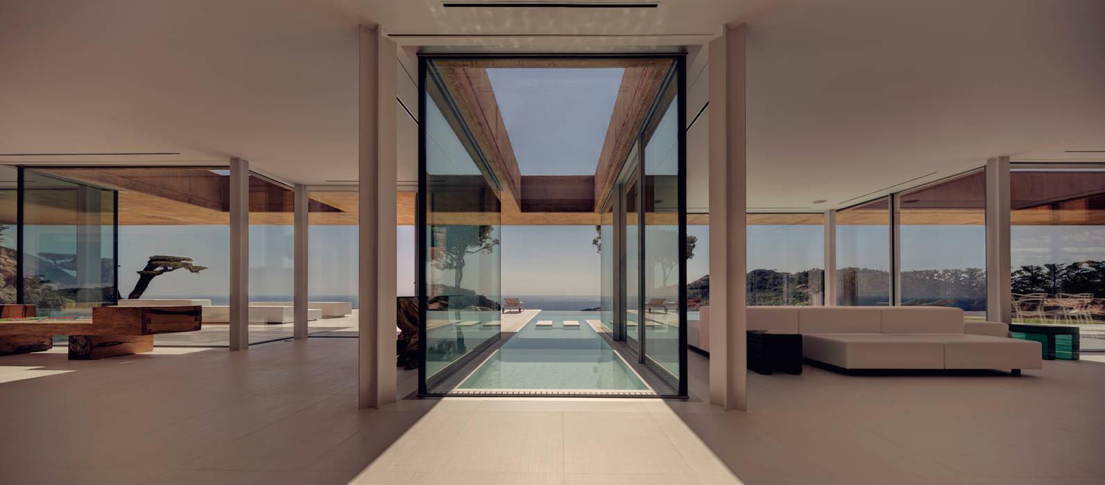 Rehabilitación de vivienda unifamiliar en Begur, Costa Brava, Baix Empordá: Salones de estilo  de MANO Arquitectura