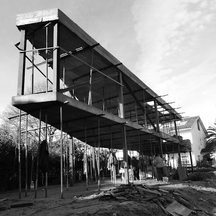 Casas de estilo minimalista por thk construcciones homify for Construcciones minimalistas