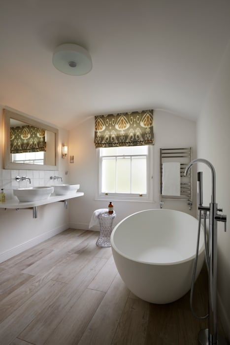 Stylish white bathroom with rustic textures:  Bathroom by ZazuDesigns,