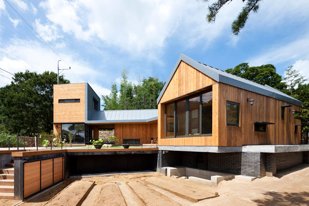 Ssangdalri House: hyunjoonyoo architects의  정원,