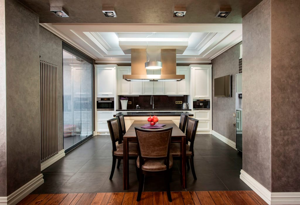 Minimalist dining room by Studio B&L Minimalist
