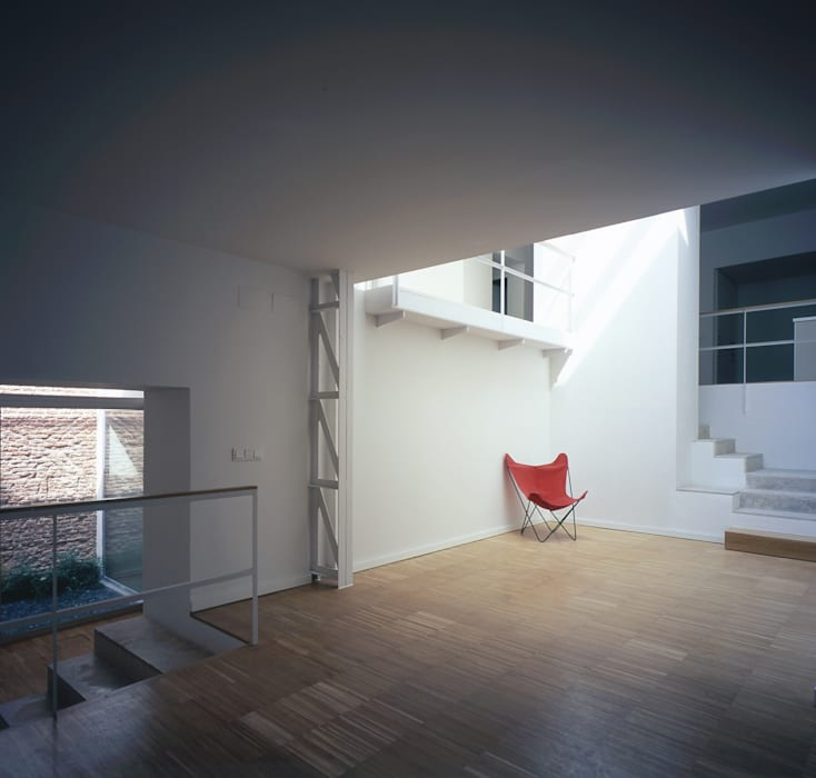 REHABILITACIÓN DE EDIFICIO CONDE DE ROMANONES. Madrid: Dormitorios de estilo industrial de Beriot, Bernardini arquitectos