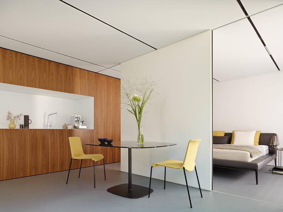 Modern dining room by WERNER SOBEK Modern