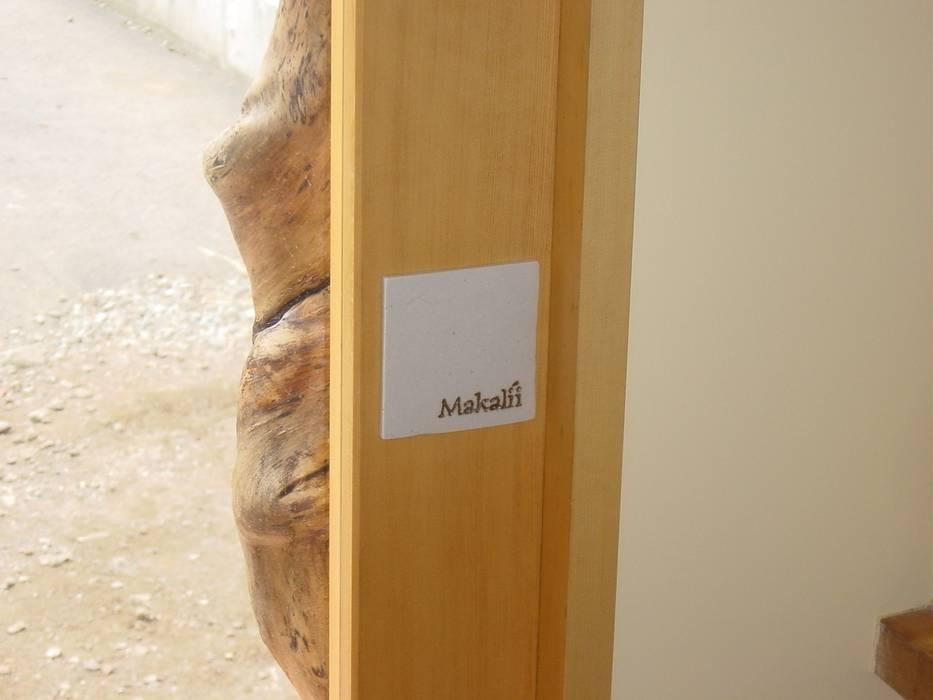 ドア 押手: 伊達剛建築設計事務所が手掛けた窓です。