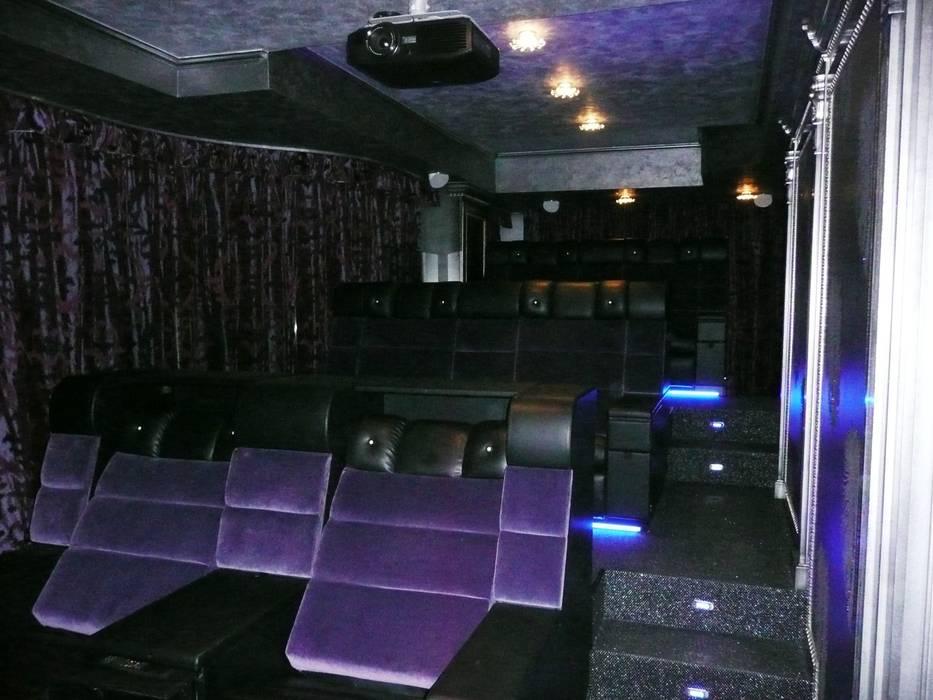 Home Cinema: Sala multimediale in stile  di Architetturambiente st.ass. Bosi e Soloni