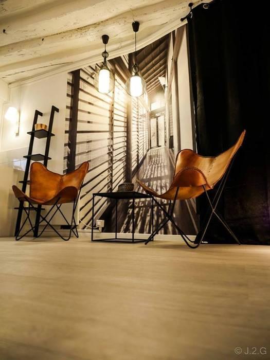 Décoration de l'Accueil d'un Spa à Paris: Locaux commerciaux & Magasins de style  par At Ome