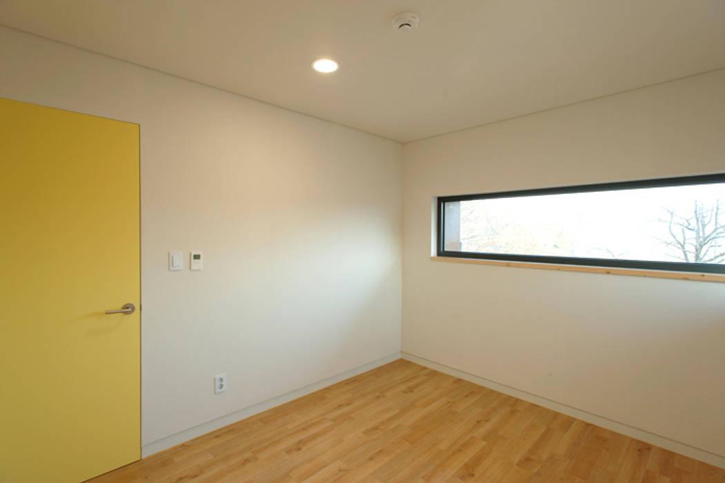 (주)오우재건축사사무소 OUJAE Architects:  tarz Yatak Odası, Modern