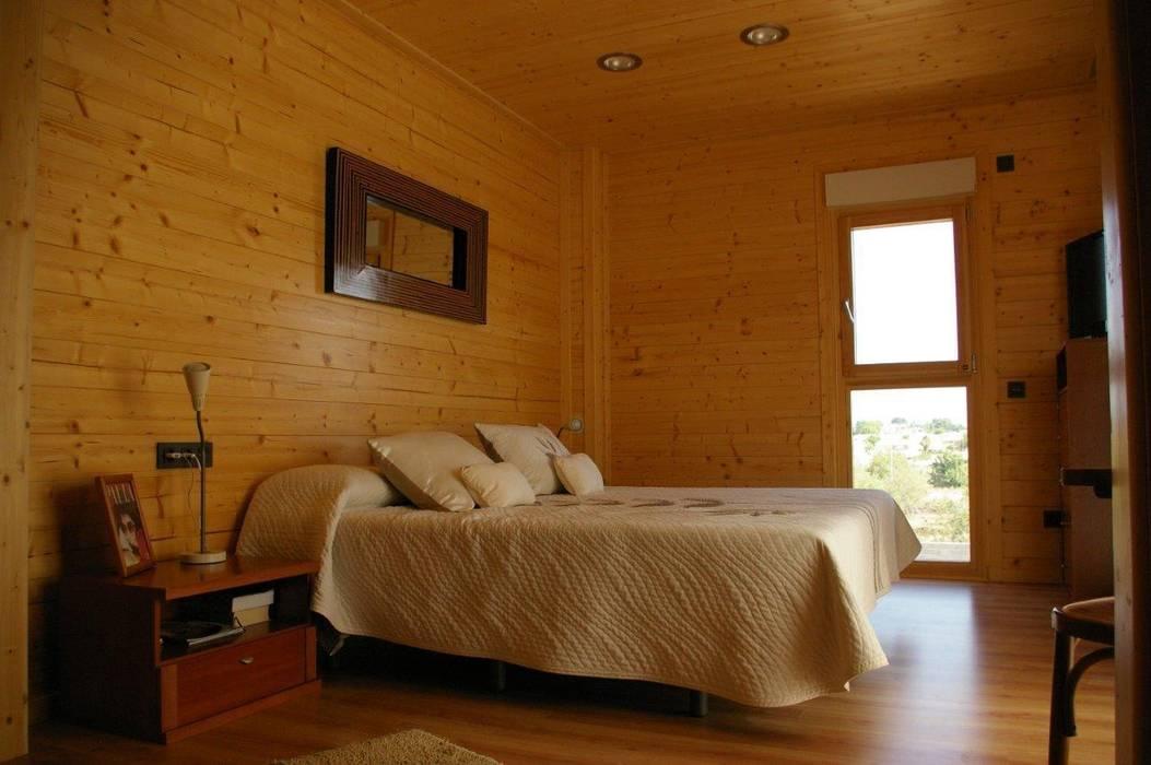 Suite principal Natura Rosso 165 Dormitorios de estilo moderno de Casas Natura Moderno