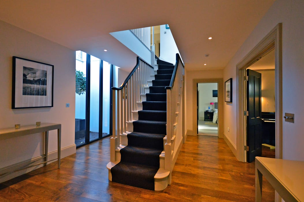 The stairs to the basement Modern corridor, hallway & stairs by Zodiac Design Modern