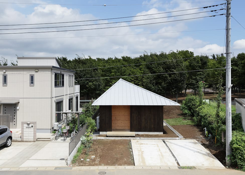 三角屋根の家 モダンな 家 の m・style 一級建築士事務所 モダン 木 木目調
