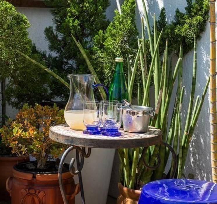 Terraço: Jardins  por Blacher Arquitetura