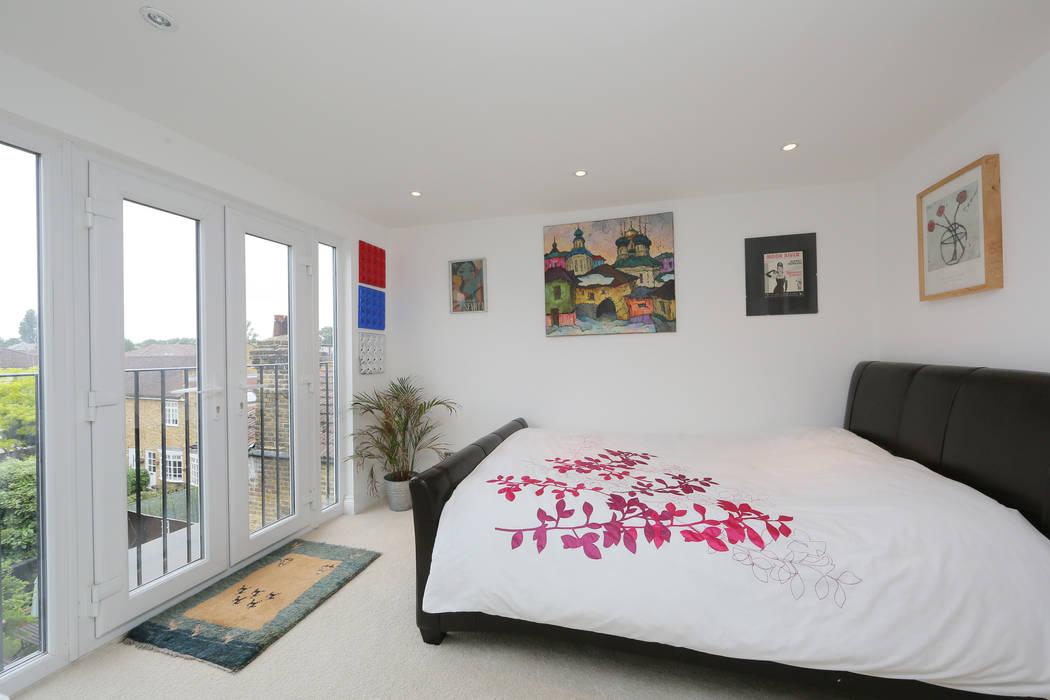 hip to gable loft conversion wimbledon homify Dormitorios de estilo moderno