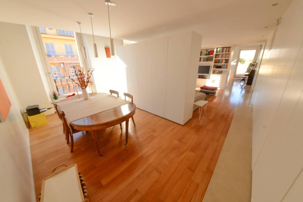 13. Ambienti modificabili: Sala da pranzo in stile in stile Moderno di Studio Fori