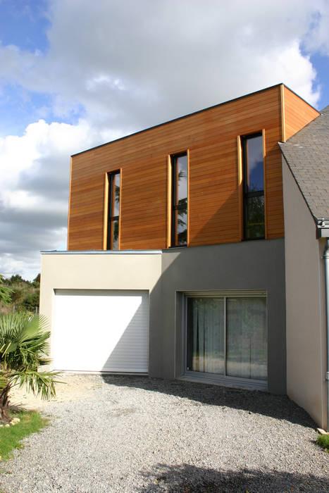 De bois et de béton...: Maisons de style de style Moderne par A2 ARCHITECTURE