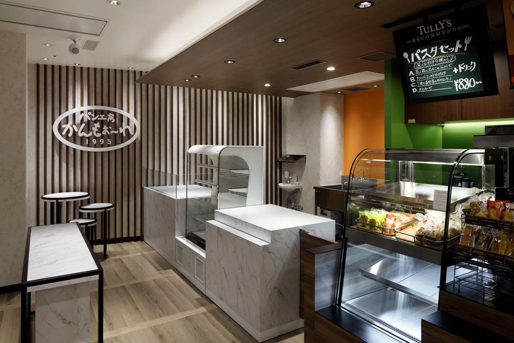 タリーズコーヒー_レム鹿児島店: ドイルコレクションが手掛けた商業空間です。,モダン