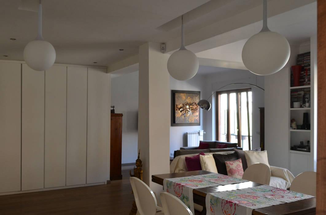 Il soggiorno pranzo soggiorno minimalista di arch paolo for Soggiorno minimalista